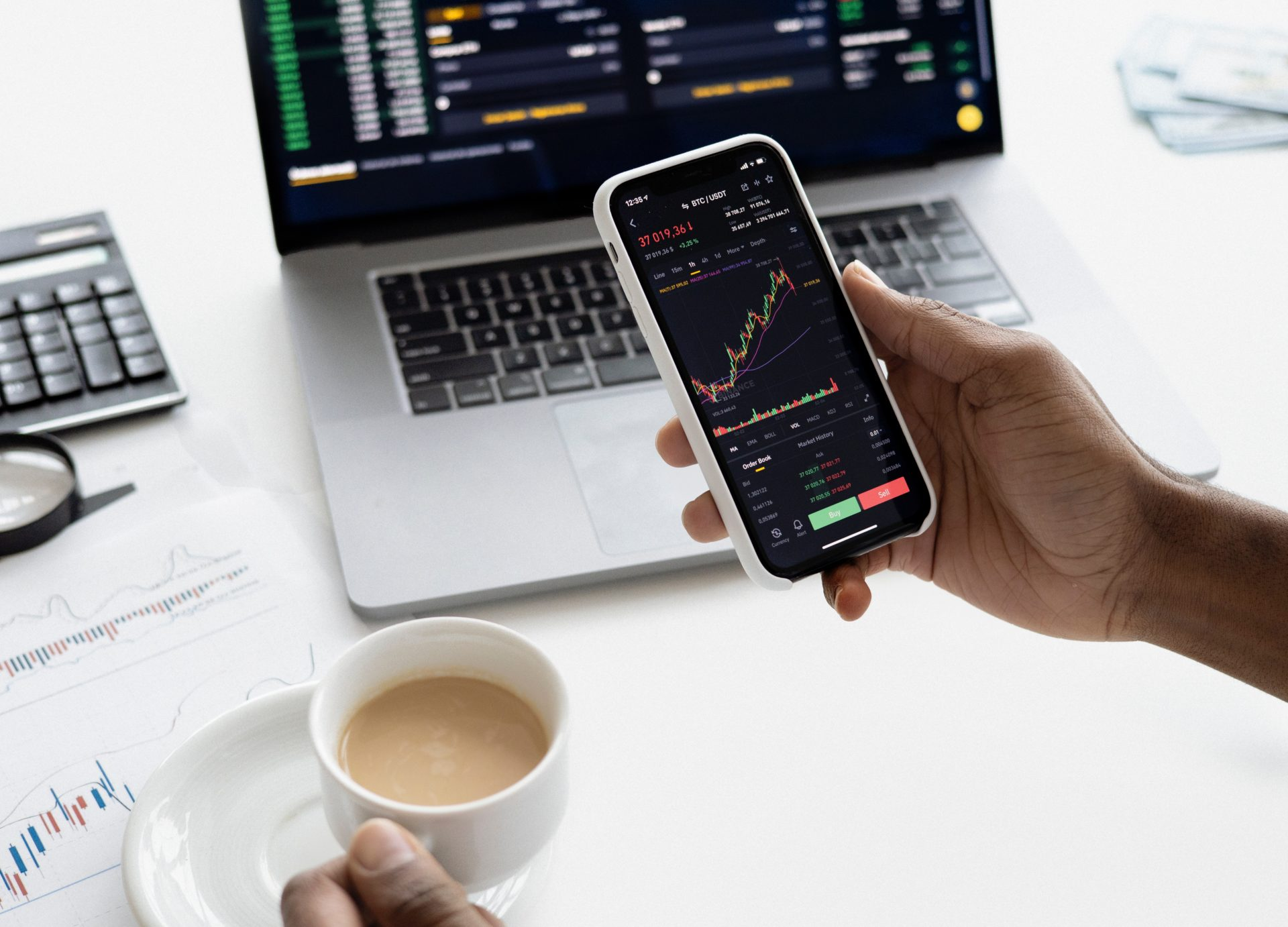 a person checking a stock price on his phone